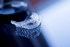 Aligners for Invisalign in Bloomfield on reflective tabletop